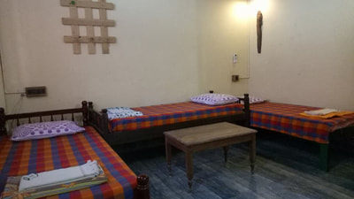 dormitory room with 4 single beds and 1 futon bed comes with ensuite toilet, basic kitchen, private patio, hot and cold water, free wifi