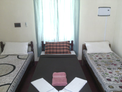 dormitory room with single beds in fort kochi